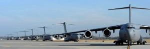 Formation of U.S. Air Force C-17 Globemaster III's Prepare for Departure by Stocktrek Images