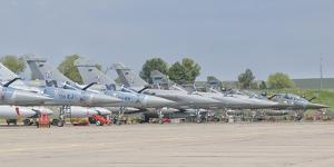 French Air Force and Royal Saudi Air Force Planes on the Flight Line by Stocktrek Images
