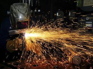 Hull Maintenance Technician Welds Scrap Metal by Stocktrek Images