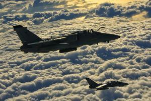 Italian Air Force Amx-Acol Aircraft Flying Above the Clouds by Stocktrek Images
