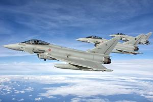 Italian Air Force F-2000 Typhoon Aircraft Fly in Formation by Stocktrek Images