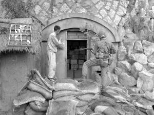 Korean Civilian Shows US Marine Dynamite Cache Near Inchon, South Korea by Stocktrek Images