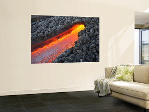 Lava Flowing from Small Tunnel on Flank of Pacaya Volcano, Guatemala by Stocktrek Images