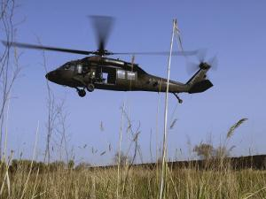 March 31, 2007, a US Army UH-60 Black Hawk Helicopter Prepares to Pick up Soldiers by Stocktrek Images
