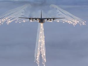 MC-130H Combat Talon Dropping Flares by Stocktrek Images