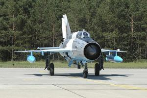 Mig-21 Lancer of the Romanian Air Force by Stocktrek Images