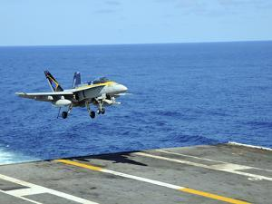n F/A-18C Hornet Lands Aboard the Aircraft Carrier USS Ronald Reagan by Stocktrek Images
