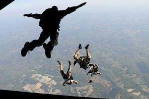 Navy Seals Jump from the Ramp of a C-17 Globemaster Iii over Virginia by Stocktrek Images
