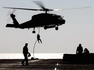Personnel Fast-Rope out of an SH-60F Seahawk Helicopter by Stocktrek Images