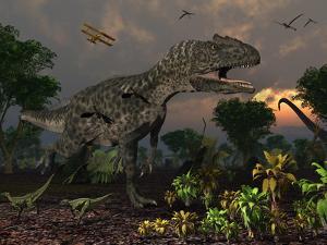 Prehistoric Dinosaurs Roam Freely Where Time Stands Still by Stocktrek Images