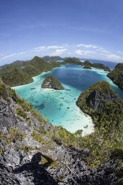 Rugged Limestone Islands Surround a Gorgeous Lagoon in Raja Ampat by Stocktrek Images