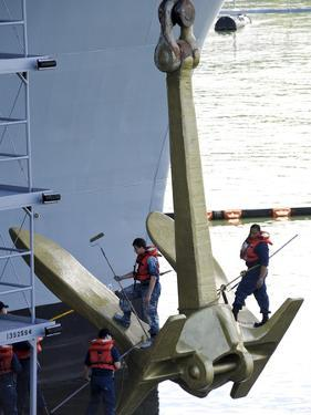 Sailors Paint the Starboard Anchor of the Aircraft Carrier USS Nimitz by Stocktrek Images