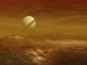 Saturn Above the Thick Atmosphere of its Moon Titan by Stocktrek Images