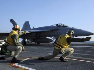 Shooters Aboard the USS George H.W. Bush Give the Go-Ahead Signal to Launch an F/A-18 Super Hornet by Stocktrek Images