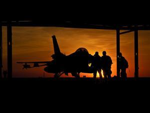 Silhouette of a Chilean Air Force F-16C Block 50 at Natal Air Force Base, Brazil by Stocktrek Images
