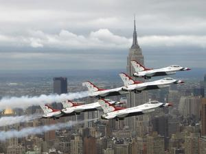 Six F-16 Fighting Falcons with the U.S. Air Force Thunderbirds Fly in Delta Formation by Stocktrek Images