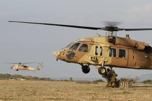 Soldiers Practice External Cargo Mounting on a Uh-60 Yanshuf of the Israel Air Force by Stocktrek Images