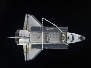 Space Shuttle Atlantis Backdropped Against the Blackness of Space by Stocktrek Images