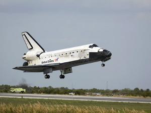 Space Shuttle Discovery Approaches Landing on the Runway at the Kennedy Space Center by Stocktrek Images
