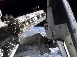 Space Shuttle Discovery Docked to the International Space Station by Stocktrek Images