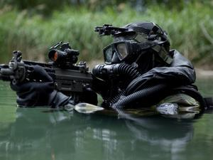 Special Forces Combat Diver Takes a Look at His Compass by Stocktrek Images