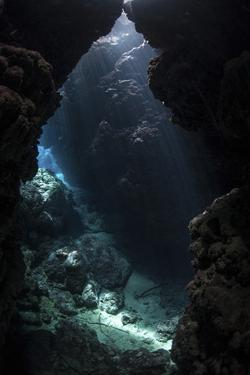 Sunlight Pours into a Submerged Cavern on a Reef in the Solomon Islands by Stocktrek Images