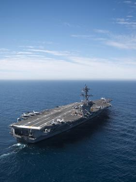 The Aircraft Carrier USS Carl Vinson in the Pacific Ocean by Stocktrek Images