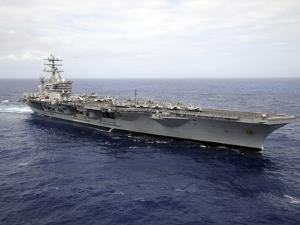 The Aircraft Carrier USS Nimitz Transits the Pacific Ocean by Stocktrek Images