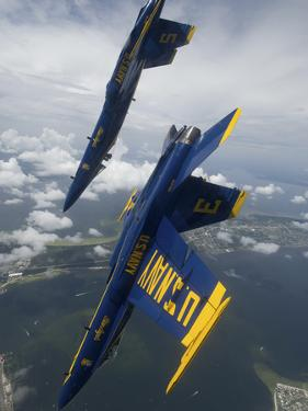 The Blue Angels Perform a Looping Maneuver Over Pensacola Beach, Florida by Stocktrek Images
