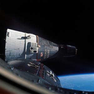 The Gemini 7 Spacecraft in Earth Orbit by Stocktrek Images
