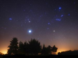 The Pleiades, Taurus And Orion with Jupiter Over Doyle, Argentina by Stocktrek Images