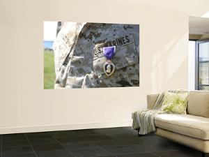 The Purple Heart Award Hangs over the Heart of a U.S. Marine by Stocktrek Images