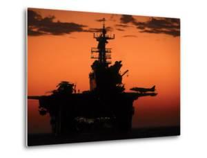 The Setting Sun Silhouettes the Amphibious Assault Ship USS Makin Island by Stocktrek Images