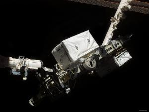 The Space Shuttle Endeavour's Remote Manipulator System (RMS) Robotic Arm August 14, 2007 by Stocktrek Images
