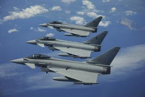 Three Italian Air Force Ef2000 Aircraft in Flight over the Mediterranean by Stocktrek Images