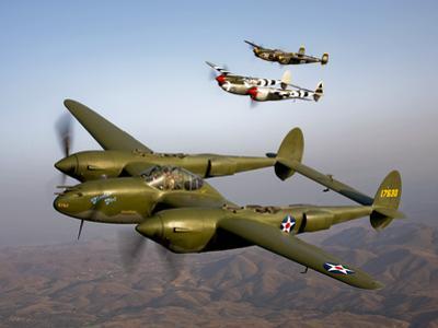 Three Lockheed P-38 Lightnings in Flight by Stocktrek Images