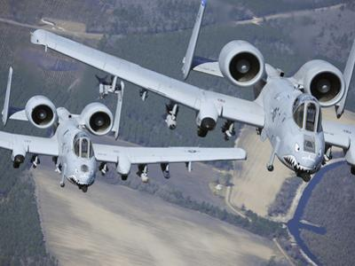 Two A-10C Thunderbolt II Aircraft Fly in Formation by Stocktrek Images