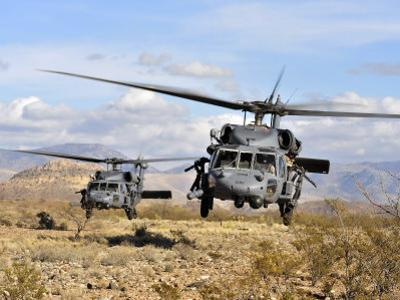 Two HH-60 Pavehawk Helicopters Preparing to Land