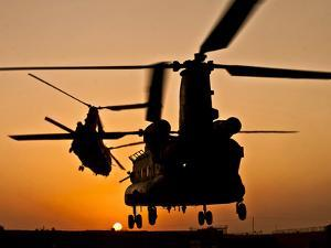 Two Royal Air Force CH-47 Chinooks Take Off from Headquarters in Afghanistan by Stocktrek Images