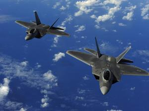 U.S. Air Force F-22 Raptors in Flight Near Guam by Stocktrek Images