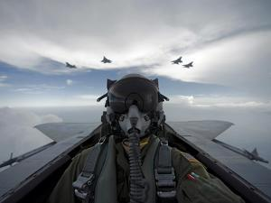 U.S. Air Force Pilot Takes a Self Portrait During a Sortie with F-15 Eagles And F-22 Raptors by Stocktrek Images