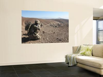 U.S. Army Soldier Provides Security for Infantry Patrolling Through Dandarh Village, Afghanistan by Stocktrek Images
