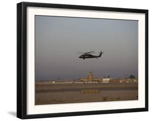 UH-60 Blackhawk Helicopter Flies Past the Tower on Camp Speicher by Stocktrek Images