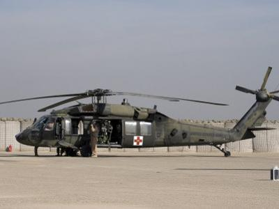 UH-60 Blackhawk Medivac Helicopter Refuels at Camp Warhorse after a Mission by Stocktrek Images