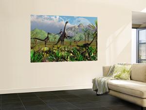 Velociraptor Dinosaurs Attack a Camarasaurus for their Next Meal by Stocktrek Images