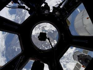 View of Earth Through the Cupola On the International Space Station by Stocktrek Images