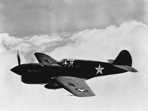 Vintage World War II Photo of a P-40 Fighter Plane by Stocktrek Images