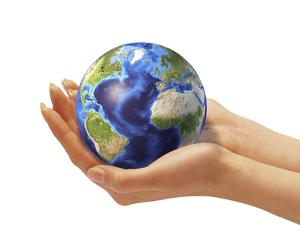 Woman's Hands Holding An Earth Globe by Stocktrek Images