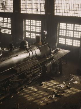 Working on a Locomotive at the 40th Street Railroad Shops, Chicago, Illinois by Stocktrek Images
