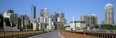 Stone Arch Bridge with Skyscrapers in the Background, Minneapolis, Minnesota, USA